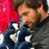 Ian Bohen holding penguin stuffed animals