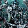 Namor, knees pulled up, underwater, sulking
