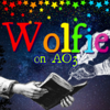 """Icon text reads """"Wolfie / on AO3"""" in rainbow letters. The background is a dark blue starry night sky; rainbow stars fall from the top. Two sketched hands in white come in from either side-one is holding a book, the other a feather quill pen."""