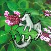 A small dragon next to a hydrangea flower