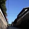 narrow street blue sky