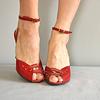 model wearing vintage red leather heels