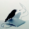 a raven with a laptop and a microphone