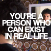 simon amstell looking in mirror in episode 1x03 of grandma's house, image superimposed with text reading 'YOU'RE A PERSON WHO CAN EXIST IN REAL LIFE'