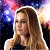 carol danvers on galaxy backdrop