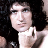 a close up picture of brian may's face