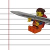 A4 lined paper with a lego man holding a silver pen up to it as if he's about to write