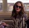 image of leighton meester as blair waldorf in gossip girl. she is wearing designer sunglasses and a devil-may-care expression
