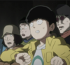 Image of Shigeo Kageyama in a yellow jacket with people behind him looking scared / surprised