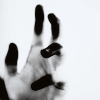 black and white hand with black fingertips and white background