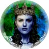 Lady Loki, actress Karie McGrath with a crown on a background of emerald green and blue fire. Half of her face is coloured blue and one of her eyes is red to symbolise Loki her Jotunn heritage.