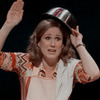 Trina in 'I'm Breaking Down' waving with a bowl over her head