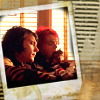Frank and Gerard's faces framed in a Polaroid