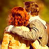 Clint Barton with his arm around Natasha Romanoff, their backs to the viewer, bright colours