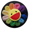 Plush Murakami rainbow-petaled flower with yellow smiling face center on black background