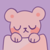 bear tucked in blanket icon