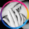 Black and white photo of my face obscured by hands with the Bi and Pan colors in a circle around it.