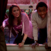 """annie edison and troy barnes from """"community"""", climbing through a window. annie looks shocked and upset, and troy looks delighted."""