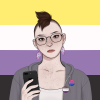 A feminine-looking person with brown hair that's shaved on the sides and longer at the top, wearing asexual and bisexual pins while standing in front of a nonbinary flag.