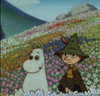 moomin and snufkin sitting in a flower field