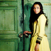 Black Sails - a picture of Max in a yellow dress in front of a green door