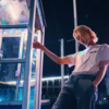 Superimposed on a Pop Vinyl of Missy from Doctor Who is Dalek Eye stalks in the place of eyes. Her umbrella has been replaced with a toilet plunger and she carries a whisk in the other hand.