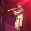 Lauren dressed as Locke Cole, playing flute on stage