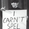 "A man holding a sign reading ""I carn't spel""."