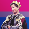 background of the colors of the bi-flag (pink, purple, blue) with in the foreground Jake Peralta from Brooklyn Nine Nine wearing a crown and cape