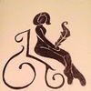 A drawing of a girl with a bob, sitting in a wheelchair, holding a quill. Black outline on sepia background.