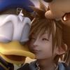 Donald and Goofy hug Sora at the end of Kingdom Hearts 2