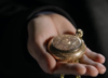 Jo Martinez's hand holding Henry Morgan's pocket watch