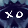 """White capital letters """"XO"""" on a black background."""