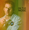 """Farscape Crighton holding a spoon on his nose. Words on picture """"on the nose"""""""