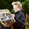 Maggie Smith as Minerva McGonagall on the Harry Potter set.  Reading the Daily Prophet in a wheelchair.