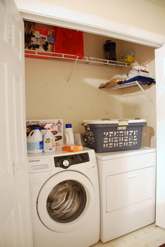 laundry closet shelving before