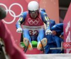 Ukraine's Andriy Mandziy falls off his luge, gets back on, finishes his run