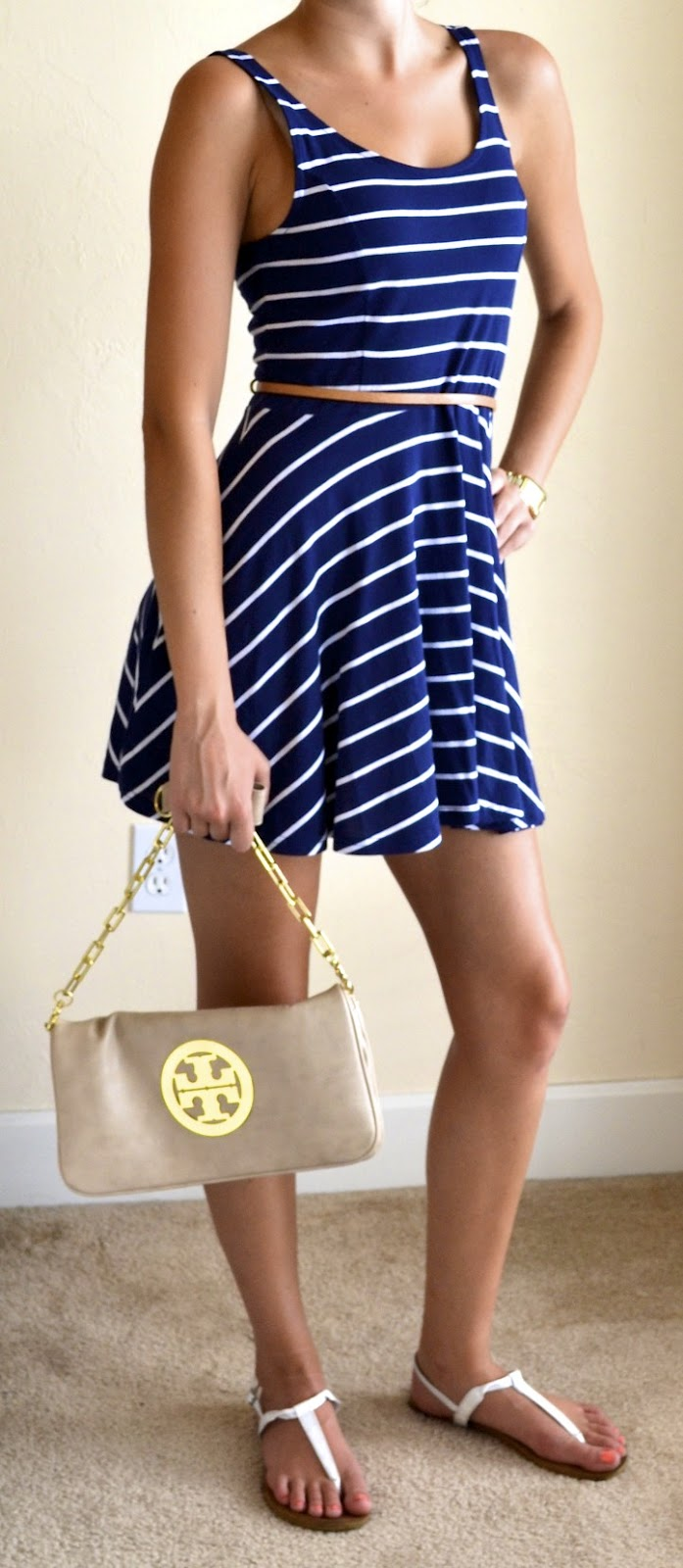 bdeeb1d0b4e2 Navy and white striped dress – H M Shoes  White sandals – Pac Sun  Accessories  Tan gold chain cross-body – Tory Burch Tan belt – JCrew