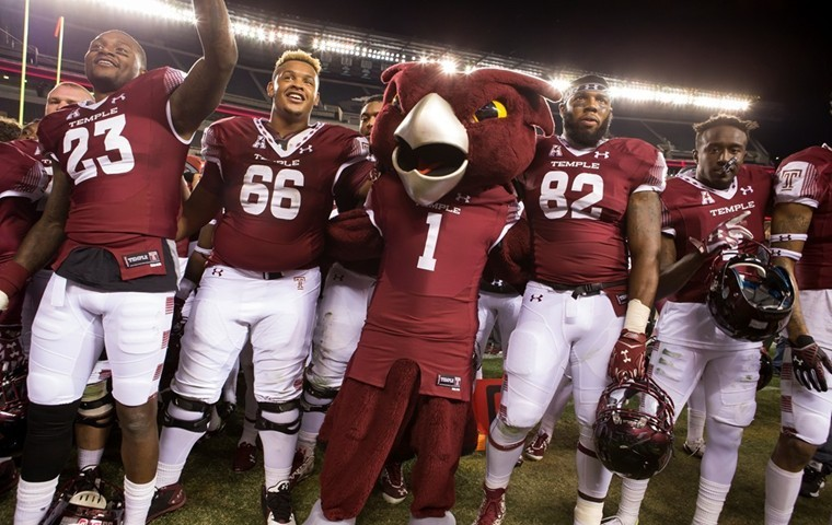 The Owls celebrate their 30-16 win over UCF