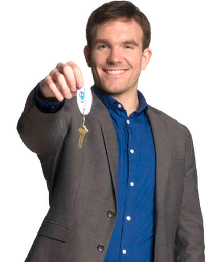 Man holding keys to a home
