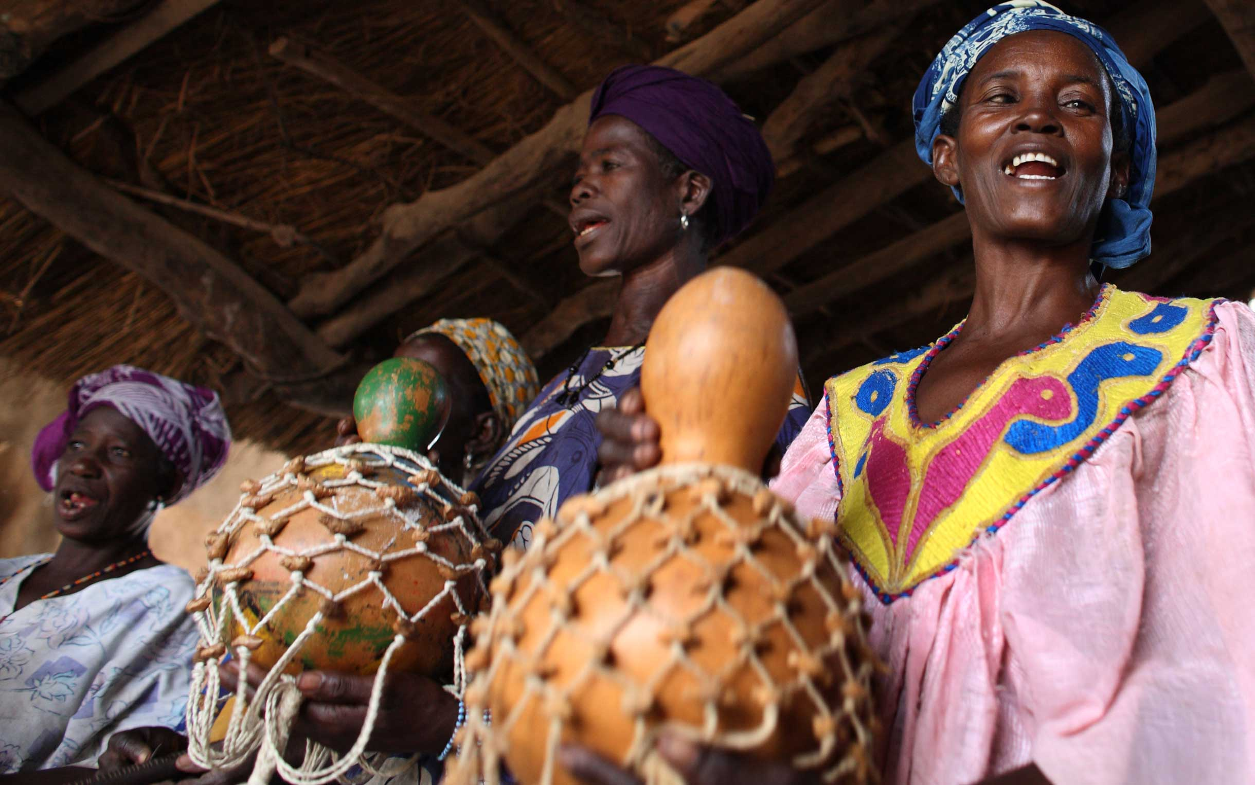 Women in Mali singing and playing instruments. Photo: Rebecca Blackwell/ Oxfam America