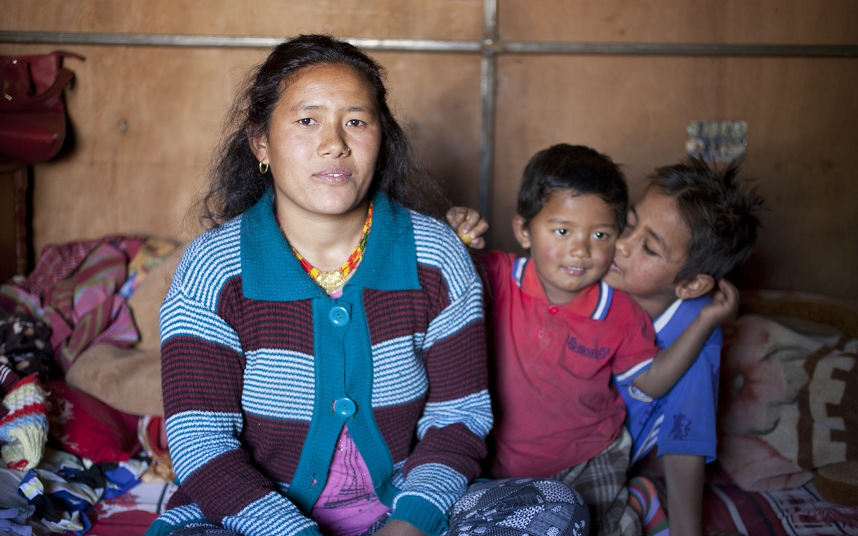 Rising from the rubble of the nepal earthquake oxfam america muna tamang giri with her sons rajesh center and aukit at their home in sindhupalchowk nepal where oxfam installed water and sanitation facilities after ccuart Images