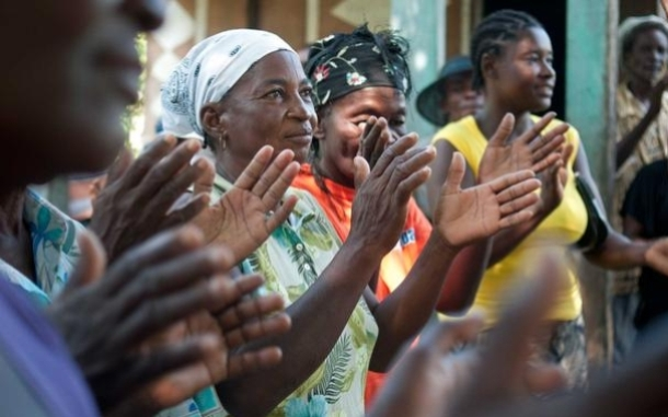 People singing at a community meeting in Haiti. Photo: Brett Eloff/Oxfam America.