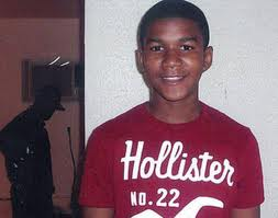 Photograph of Trayvon Martin in a red T shirt