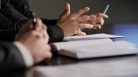 Men's hands on the table. business discussion
