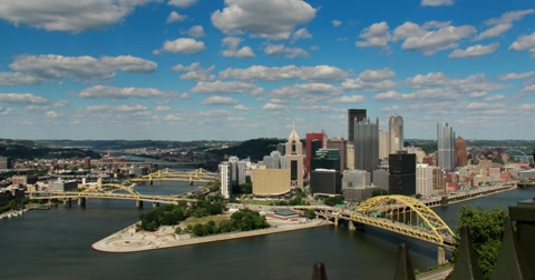 2500 Dramatic time lapse shot of a summer day over Pittsburgh, PA.  As seen from Mount Washington.  Corporate logos digitally removed for general usage.