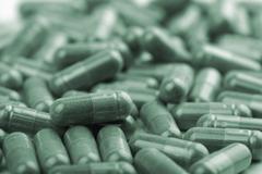 green capsule pills