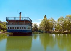 old thrown steamship costs on coast of lake