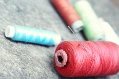 sewing spools on a woolen fiber. close-up photo