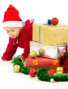 santa helper baby with christmas gifts width white background